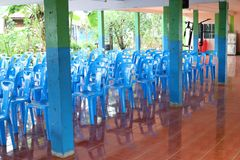 Many blue plastic chairs are arranged on the floor for meetings. Many blue plastic chairs arranged floor meetings stock photos