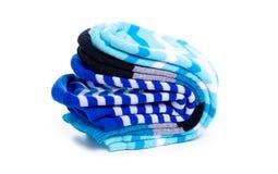 Many blue socks. On white background isolation royalty free stock image
