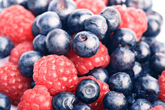 Many blueberries & raspberries Royalty Free Stock Photos