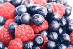 Many blueberries & raspberries Royalty Free Stock Photos