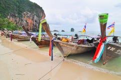 Many boat onthe beach, Thailand. Pi Pi Island, Thailand - November 14: Crowded beach with tourists all over in winter November 14, 2010 on Pi Pi Island beach Royalty Free Stock Photos