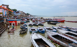 Many boats on the Ganges river in Varanasi, India Stock Photo
