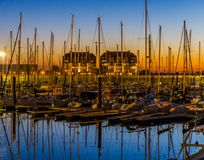 Many boats in the harbor of blankenberge at sunset, beautiful scenery in a popular Belgian city stock images