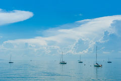 Many boats on the lake with beautiful clouds Royalty Free Stock Image