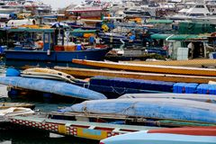 Many boats near the pier in the seaport background royalty free stock photography