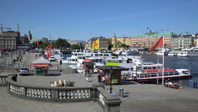 Many boats on the waterfront in the Old Town in Stockholm. STOCKHOLM, SWEDEN - MAY 2, 2016: Many boats on the waterfront in the Old Town in Stockholm stock video footage