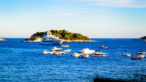 Many boats and yachts anchored in the summer near the island of Hvar Stock Photo