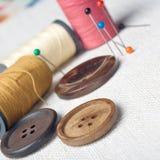 Many bobbin of thread with needle Royalty Free Stock Image