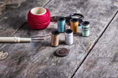 Many bobbin of thread with needle and button Stock Photo