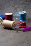 Many bobbin of thread with needle and button Royalty Free Stock Image