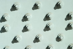 Many bolts with screw-nuts closeup Royalty Free Stock Images