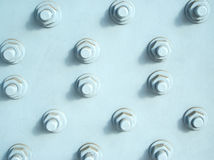 Many bolts with screw-nuts closeup Royalty Free Stock Photography