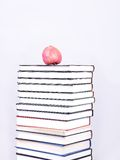 Many books with an apple on Royalty Free Stock Photography