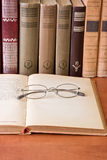 Many books and glasses Stock Photography