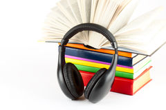 Many books with headphones Stock Photography