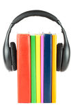 Many books with headphones Stock Images