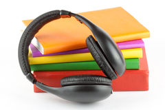 Many books with headphones Stock Photo