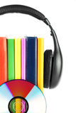Many books with headphones Royalty Free Stock Image