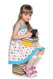 Many books or a new gadget? Stock Images