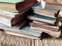 Many books on an old chair Royalty Free Stock Photography
