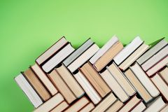 Many Books Piles. Hardback books on wooden table. Back to school. Copy space stock images
