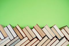 Many Books Piles. Hardback books on wooden table. Back to school. Copy space stock photos