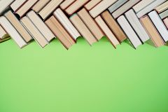 Many Books Piles. Hardback books on wooden table. Back to school stock image