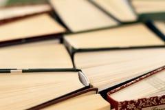 Many Books Piles. Hardback books on wooden table royalty free stock photo