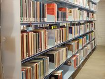 Books on a shelf in a public library. Many books on shelves in the public library Royalty Free Stock Photography