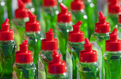 Many Bottels Green Abstergent. Many bottles with abstergent, red cap and green liquid Stock Photography