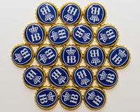 Many bottle caps of beer from Bavarian brewery Hofbrau Munich royalty free stock photography
