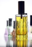 Many Bottle with Gold Perfume different color isolated. Royalty Free Stock Photo