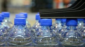 Many bottled water moves on conveyor belt stock video footage