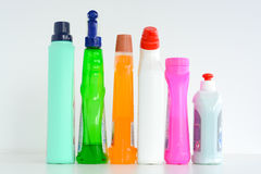 Many bottles of cleaning solutions isolated on white background Stock Photos