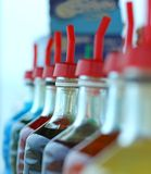 Many bottles of colored syrup for preparing ice creams Royalty Free Stock Photography