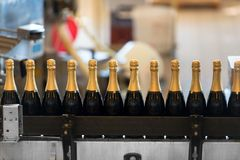 Many bottles on conveyor belt Royalty Free Stock Images