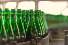 Many bottles on conveyor belt Stock Photo
