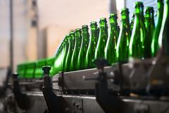Many bottles on conveyor belt Stock Image