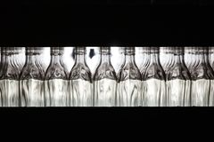 Many bottles on conveyor belt in glass factory royalty free stock image