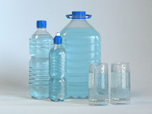 Many bottles and glass of clear water Stock Photo