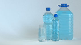 Many bottles and glass of clear water Royalty Free Stock Images