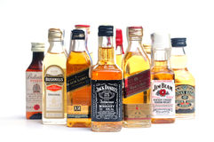 Many bottles whiskey. On white background