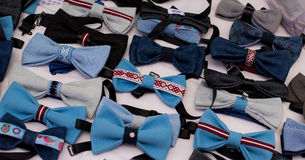Many bow ties blue color background royalty free stock photography