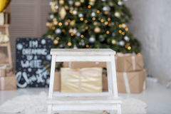 Many boxes with a christas gifts near the Christmas tree Stock Photo