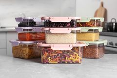 Many boxes with different food on table. In kitchen royalty free stock image