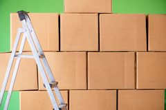 The many boxes and ladder in depot Stock Images