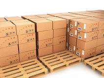 Many boxes stacked on pallets and empty trays next Stock Image