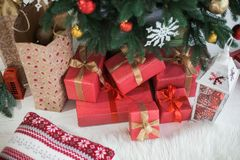 Many boxes wrapped in red festive wrapping paper Stock Image