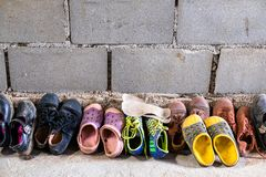 Many Boy and Girl Student Shoes in Front of the Class in Tribal School.  stock images