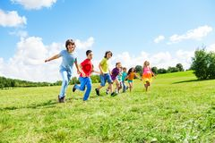 Many boys and girls running Royalty Free Stock Photo